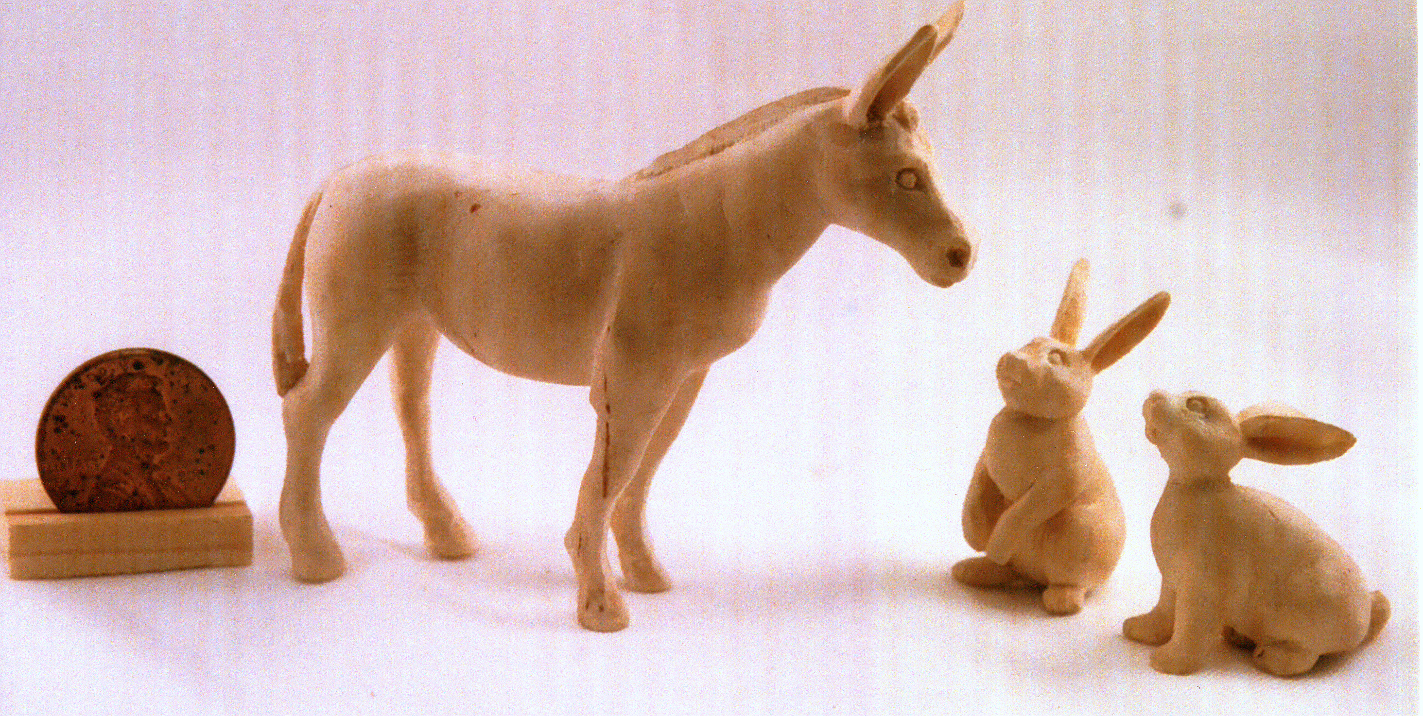 hand carved wood unpainted donkey and rabbits