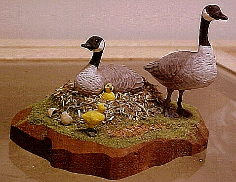 hand carved wood miniature Canada goose family