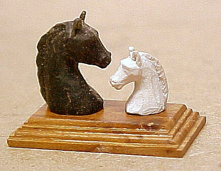 Soapstone and limestone hand carved horses
