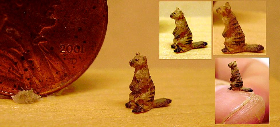 hand carved wood micro miniature mongoose