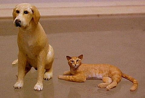 hand carved wood miniature yellow lab and orange tabby